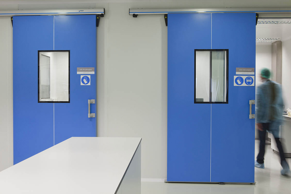 Fire safety door in insulated enclosures